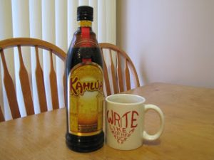 coffee cup and a bottle of Kahlua